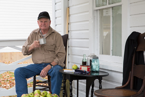 Bud Cassell sits on the porch of company house no. 236 at the Cass Scenic Railroad State Park.