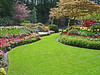 A garden and lush grass that any homeowner would die for. Beautifully designed and presented.
