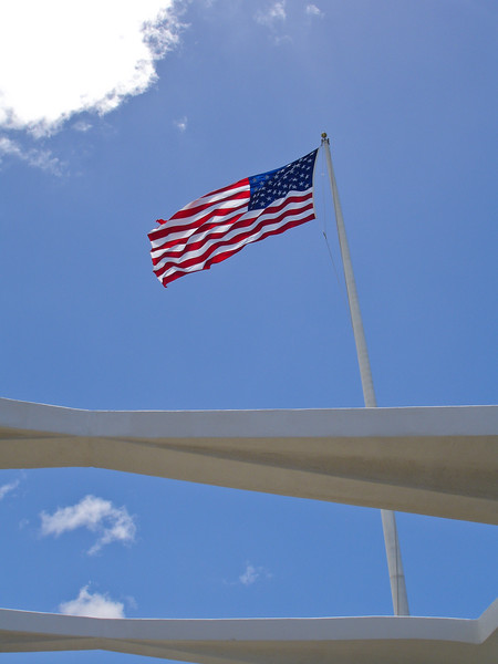 Old Glory flies above the Arizona memorial in Pearl Harbor.  It's a very moving tribute to the brave men and women who died that day defending our freedom.