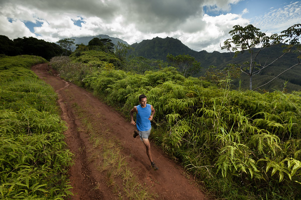 Copyright 2009 Kevin Winzeler Photography:  Athlete, Danial Velasco, runs the 11 mile power lines trail on the North Shore of Kauai, Hawaii, Wednesday, September 9, 2009.