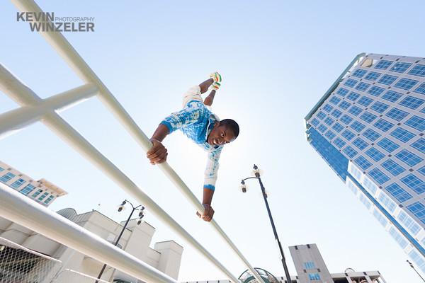 Parkour athlete, Devin Bardole does a handstand on a railiing during a Parkour session in Salt Lake City, Utah
