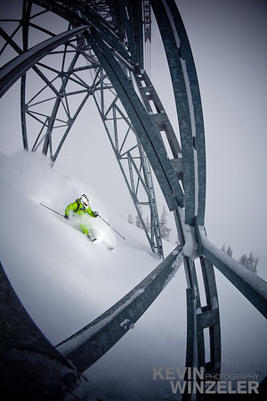 Jared Allen skis a line through the tram tower at Snowbird Ski and Summer resort in Utah