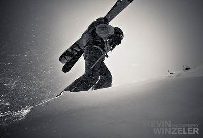 Andy Jacobsen hikes uphill in the backcountry in search of fresh tracks.