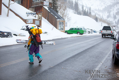 Skier Gregg Trawinski crosses little cottonwood canyon road toward the backcountry of the wasatch mountains.