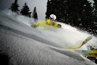 Athlete Jason West arcs a powder turn at dusk during a snowstorm in the cottonwood canyons of Utah.  The image was taken during the Salt Lake Shootout competition in 2010.