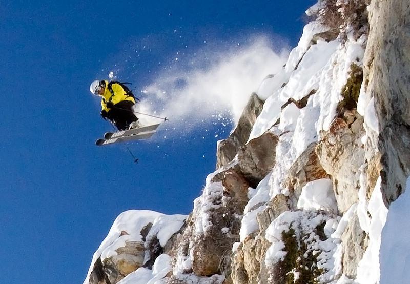 A 100% crop of Jason West at lift-off over the fantasy ridge cliffs at Solitude Ski resort.