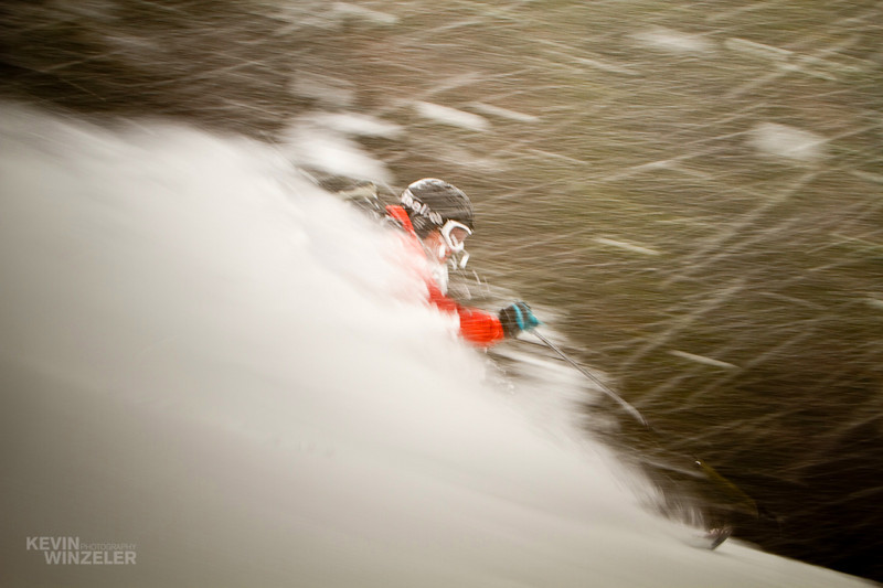 Professional skier Andy Jacobsen makes a powder turn amidst at Brighton Ski resort during the 2010 SLC shotout in Utah.