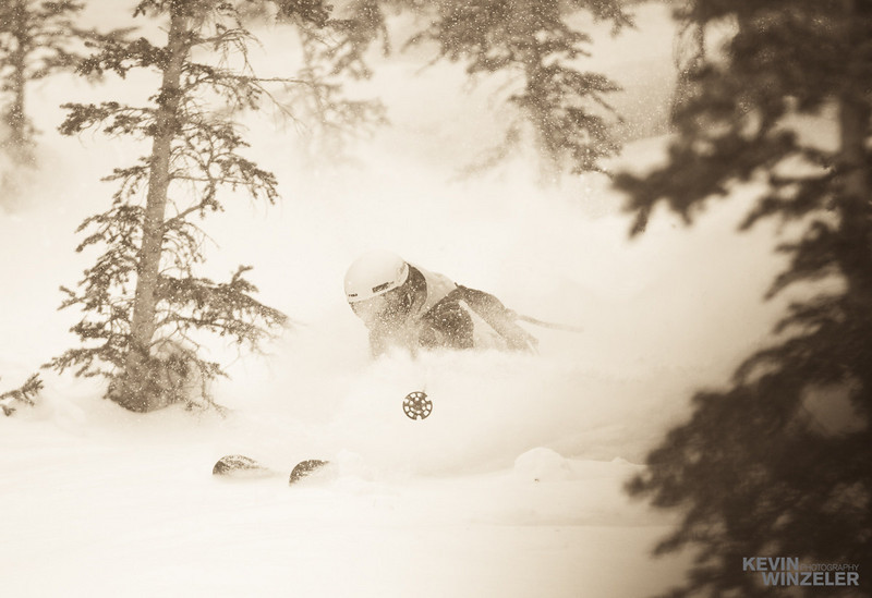 Jason West puts in a deep turn at Brighton Ski resort during flat light conditions.