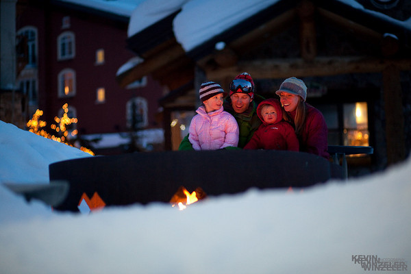 This mountain lifestyle photograph was created at Solitude ski resort of the West family.  Sitting around a fire, laughing and playing with your family after a long day of skiing in the wasatch mountains.  Not bad!
