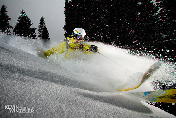 Powder skiing in Utah.  This image captures athlete Jason West making a turn after a freshly fallen layer of snow.