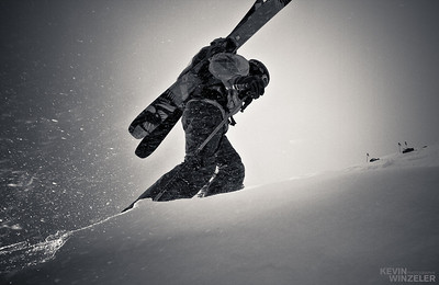 Athlete Andy Jacobsen hiking into the backcountry near Brighton Ski resort to ski the Pioneer ridge.  The conditions on day 2 of the competition deteriorated to high winds, snow and flat light.  Creating photographs that revealed something dynamic for the SLC shootout was the goal.  A variation of this image was submitted to the Mountain Lifestyle category at the end of the week.