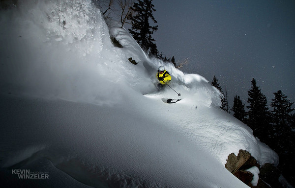 Jason West lays down a turn in some deep powder at Brighton Ski resort in Utah.