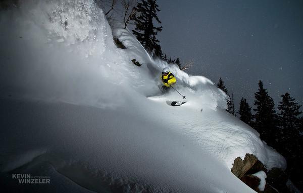 Jason West lays down a turn in some deep powder at Brighton Ski resort in Utah.