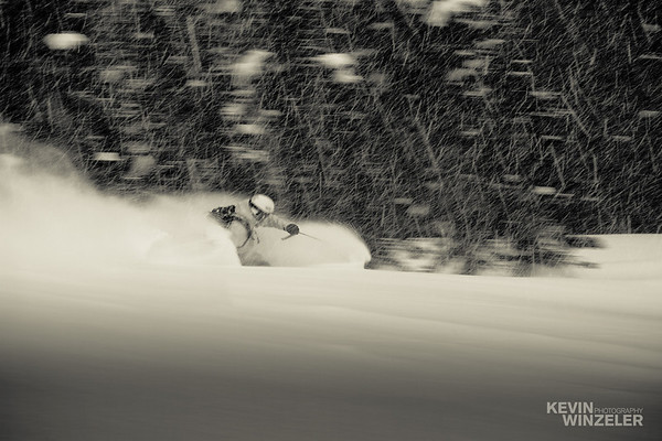 Jason West making a powder turn in the Wasatch mountains of Utah, Brighton Ski resort.  The snow was falling hard on day 2 of the competition and the skiing was awesome!