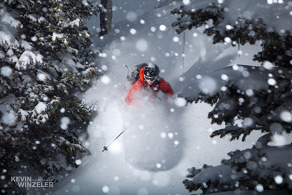 Professional skier Andy Jacobsen skiing making a turn amidst the deep powder of Alta Ski resort during the 2010 SLC shotout in Utah.