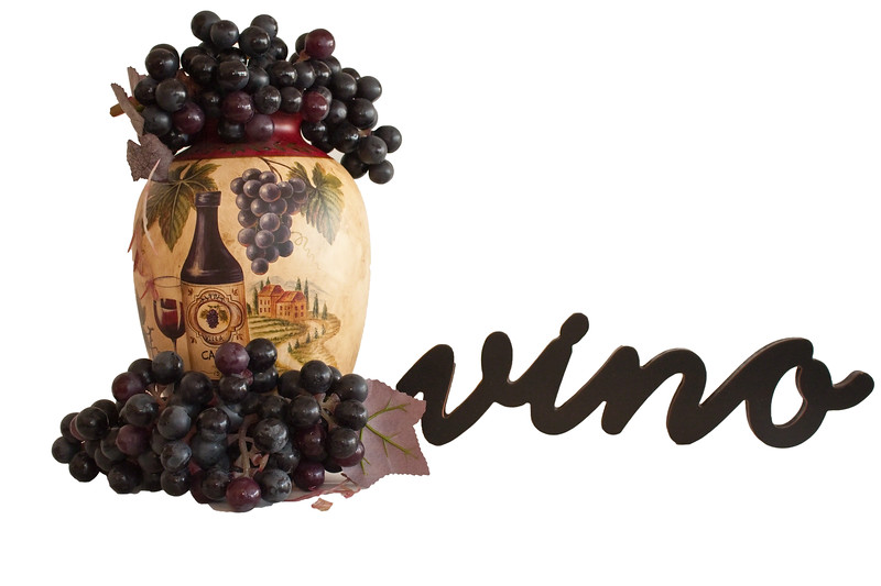 Wine grapes,vino sign and wine container on a white background.