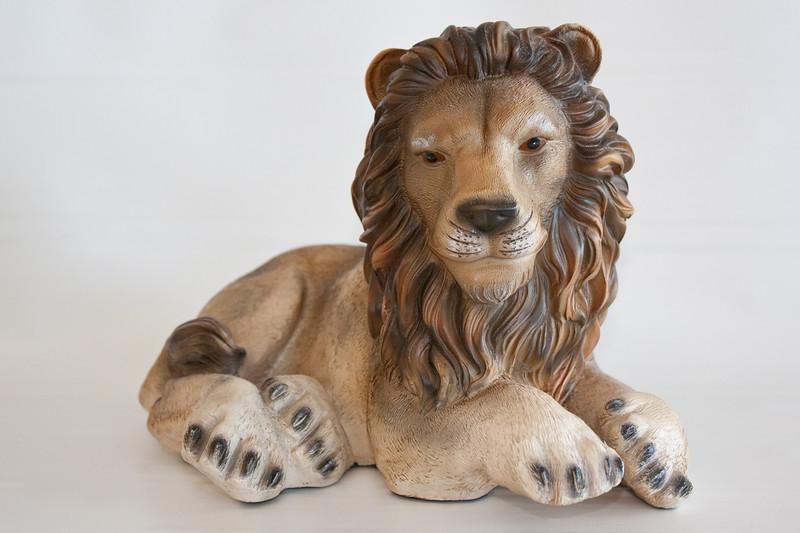 Ceramic lion on a white background.