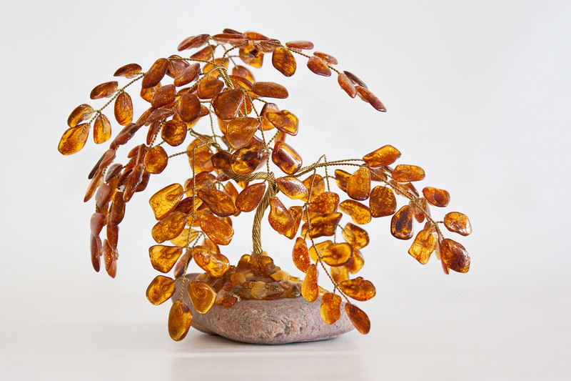 Amber tree statue on a white background.