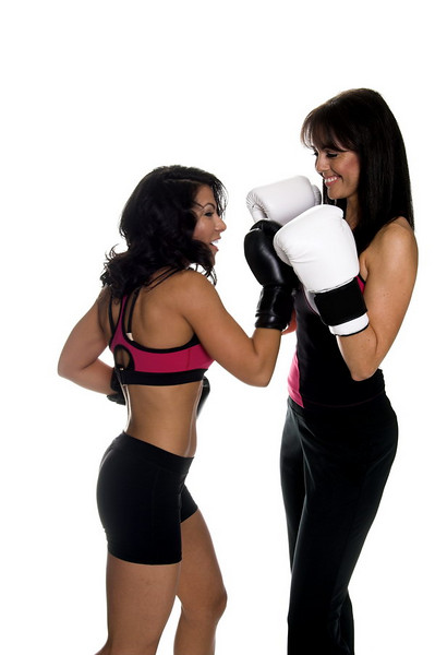 Two young women sparring and one connects with an uppercut.<br /> <br /> Some motion blur on the punching fighter