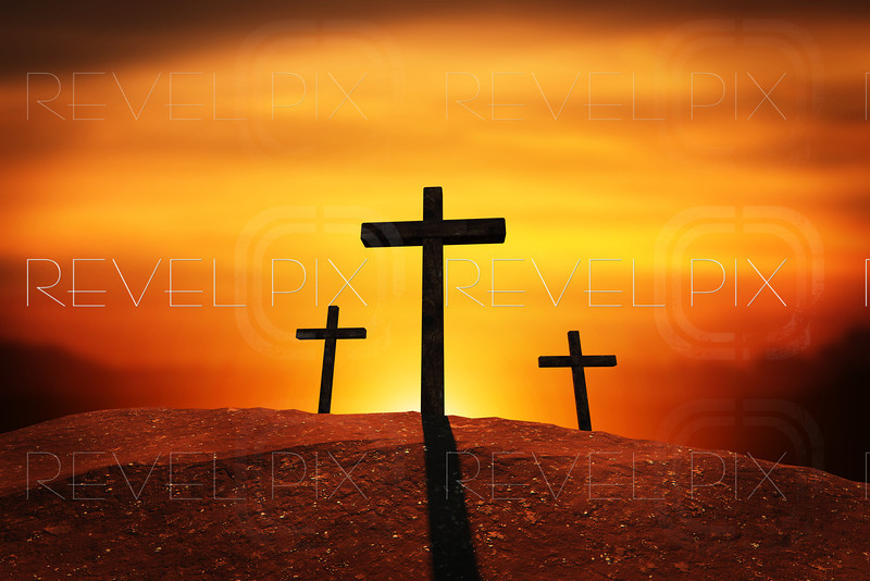 a sunset or sunrise scene of three crosses on a hill. backlit by the sun. vignett.<br /> clipping path provided to isolate crosses and hill