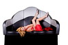 Sexy blond woman in a long red dress laying in a big retro clam shell lounge booth