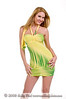 Blond fashion model in a short tight fitting green and yellow party dress