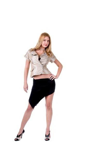Sexy blonde secratary dressed in a metallic tweill jackey and black angle cut skirt