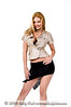 Blond fashion model in a nice business coat style top and short black skirt