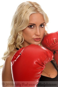 Healthy young woman in red boxing in her fight stance
