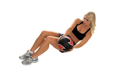 Beautiful blond fitness model doing side crunches with a 6 pound medcine ball