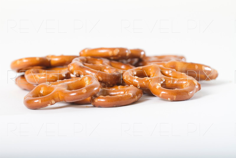 a pile of pretzels shot on white. low angle macro