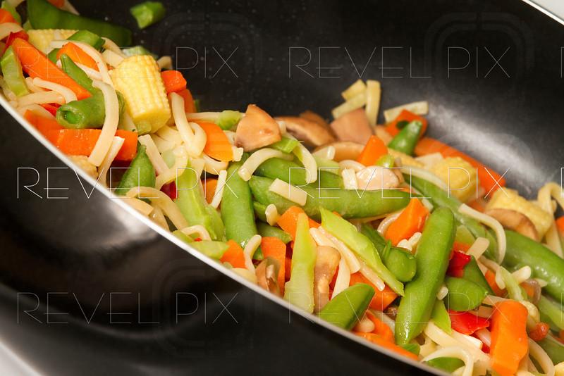 a close up of cooking a teriyaki dish. shot on an angle