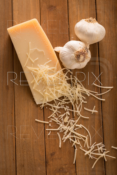Shredded Parmesan and Wedge with Garlic Above