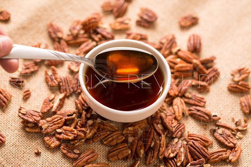 Maple Syrup in Bowl with Pecans Close Up