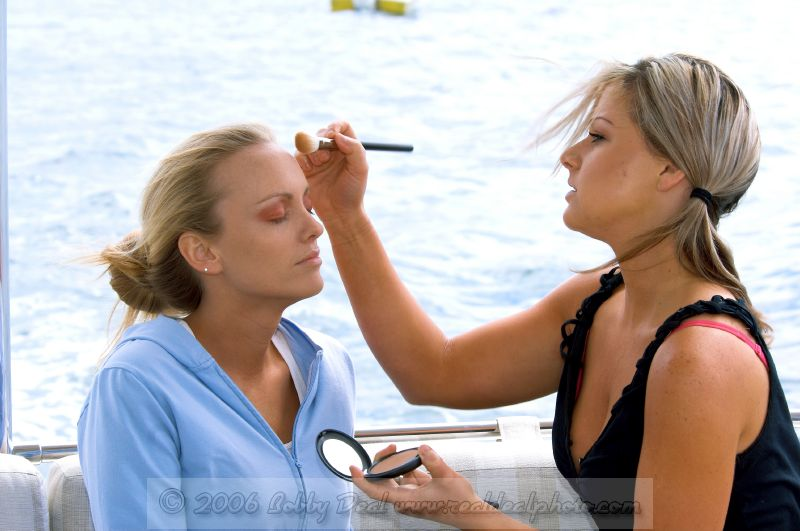 Makeup artist at work on a model on set