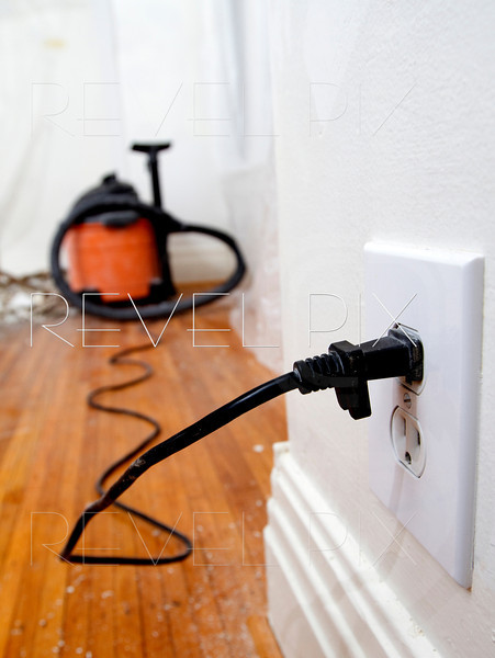 view from an outlet of a vacuum cord plugged in.