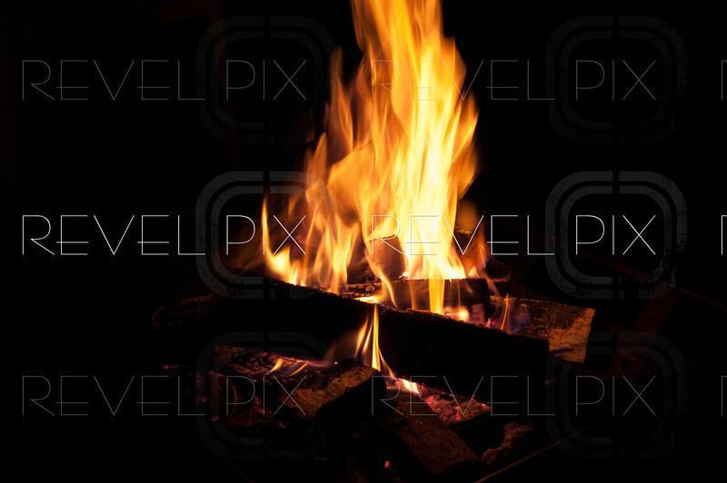 A nighttime campfire. Fire has motion blur