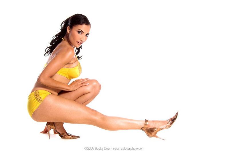Sexy brunette Go Go dancer in  yellow short shorts and bra