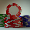 a low angle macro shot of 3 stacks of gambling chips. A red one is standing on the red stack facing the camera. great for placing logos or messages.
