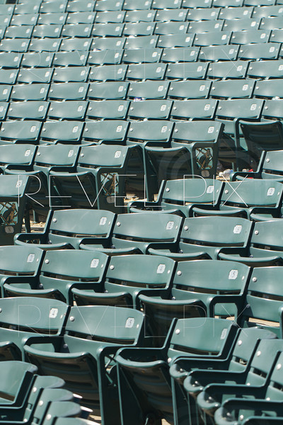 green stadium seats empty after a game.