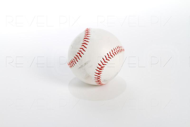 a worn and scuffed baseball shot on white