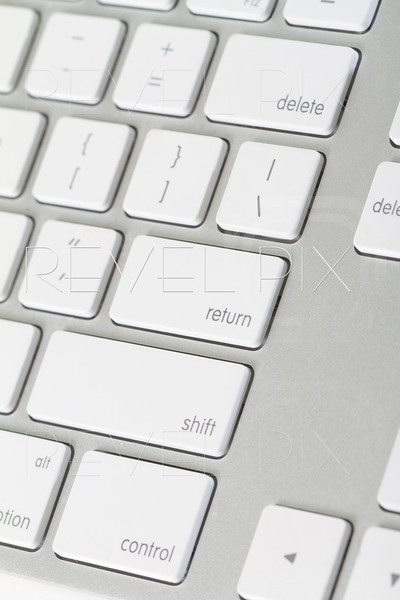 close up shot of a keyboard where the return key is