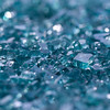 a side macro shot of broken glass. shallow depth of field and bokeh.