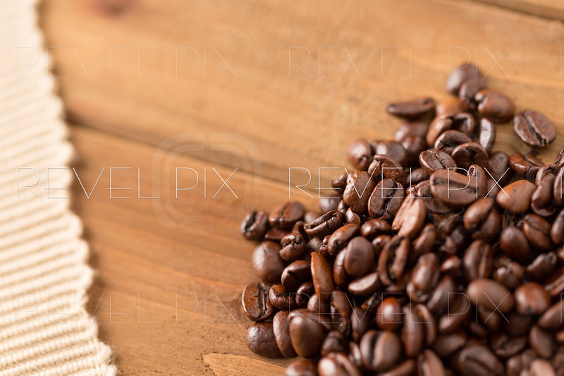 Coffee Beans and Cloth on Wood