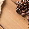 Coffee Beans on Wood Close Up