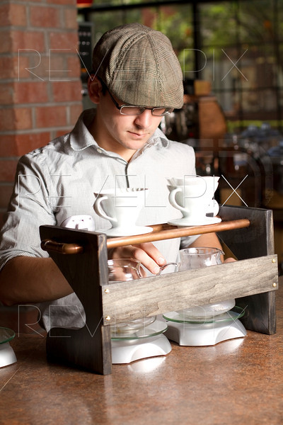 a cafe employee prepares a coffee brewing station for brewing