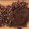 Pile of Coffee Beans and Grounds in Middle of Wood