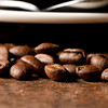 a macro shot of a pile of roasted coffee beans.