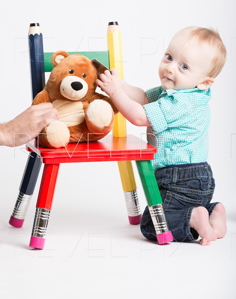 Baby Kneeling with Teddy Bear on Chair
