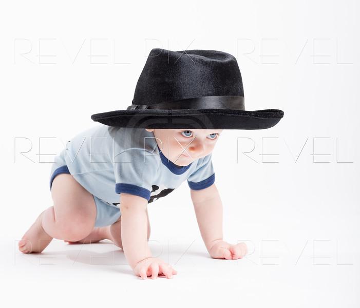 Baby Crawling Wearing a Black Fedora